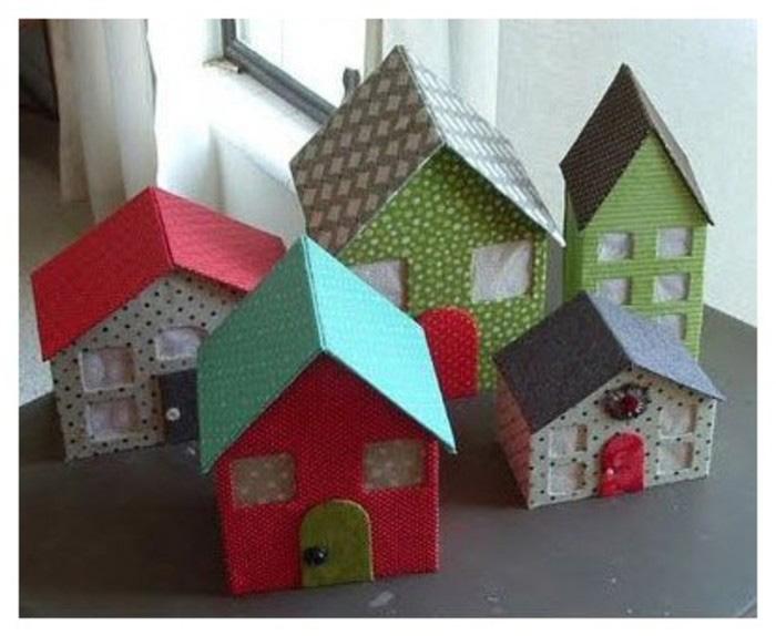 分享的是用硬纸板和布料相结合来制作一款精美的小房子的手工diy作品.图片